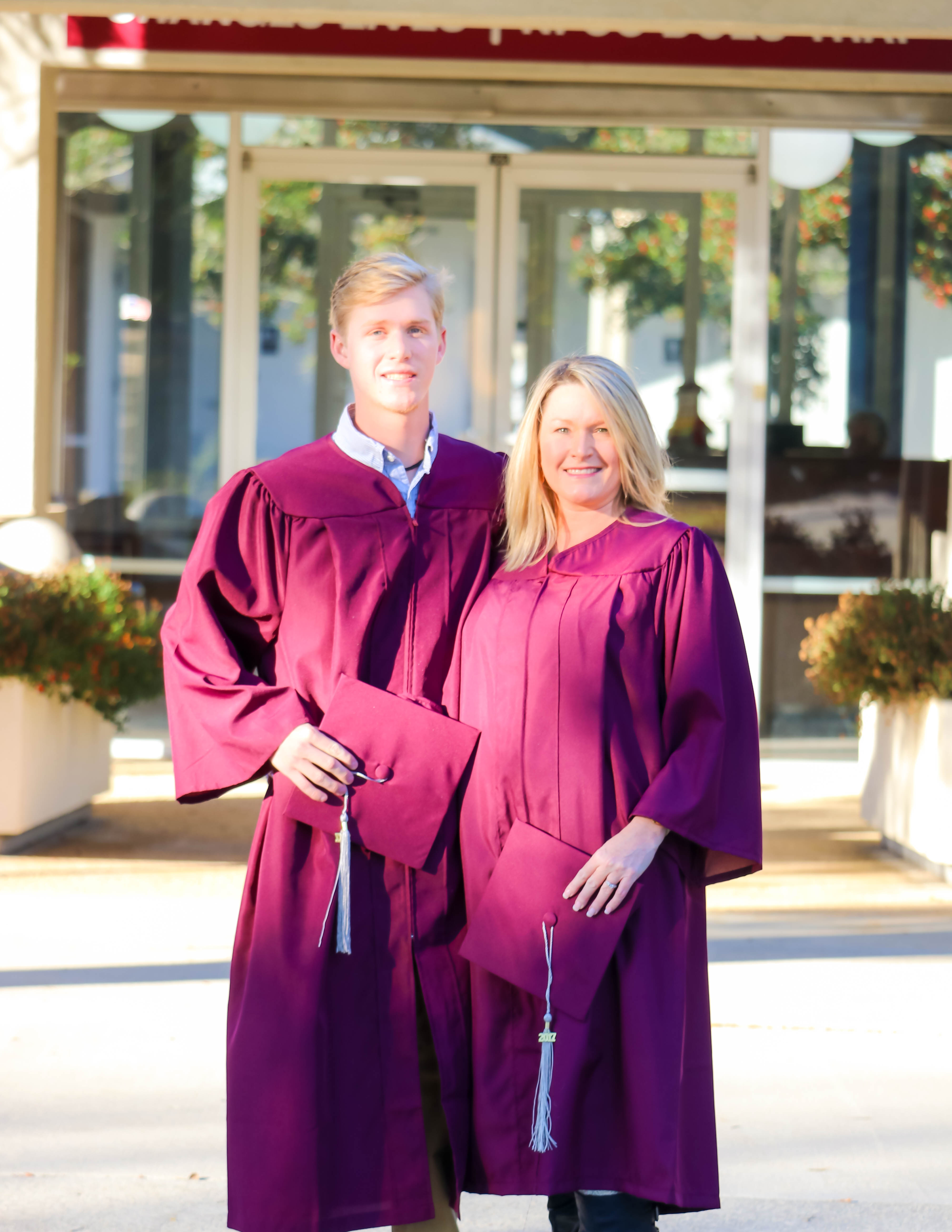 Gabe Miller and Angela Eastabrooks standing infront of North Florida Community College before graduation ceremony