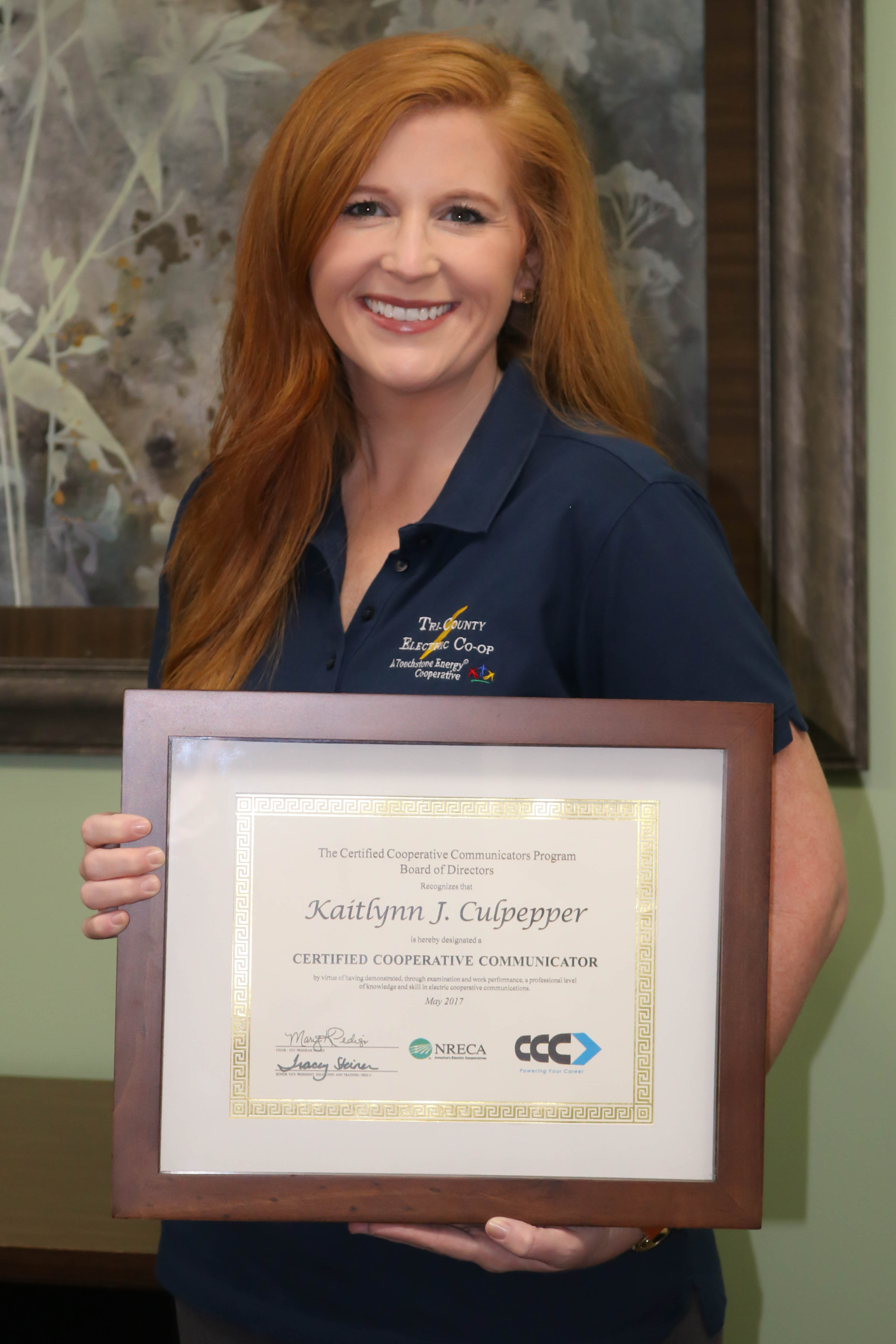 Kaitlynn Culpepper with her Certified Cooperative Communicators Certificate