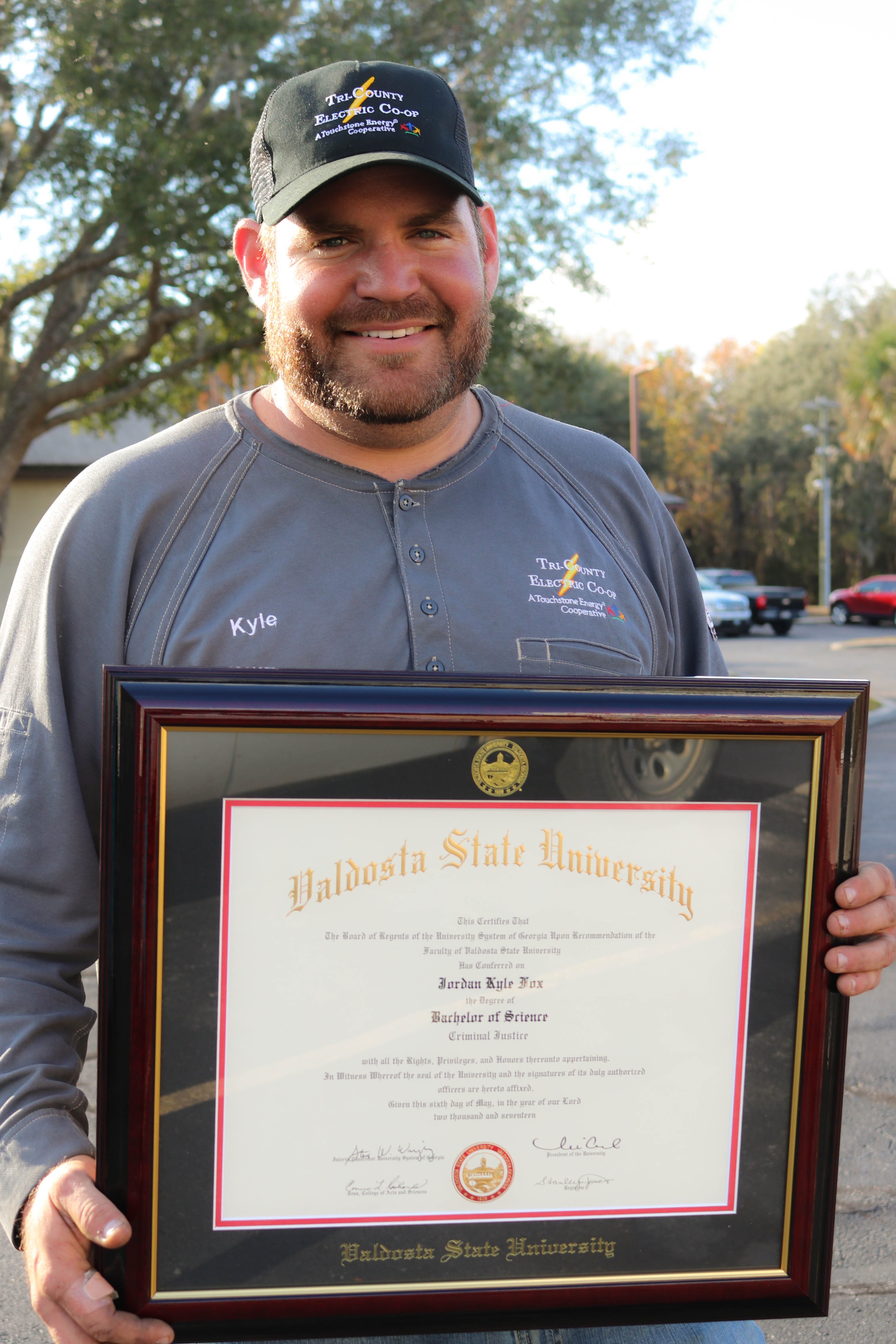 Kyle Fox with his Bachelors degree from Valdosta State University