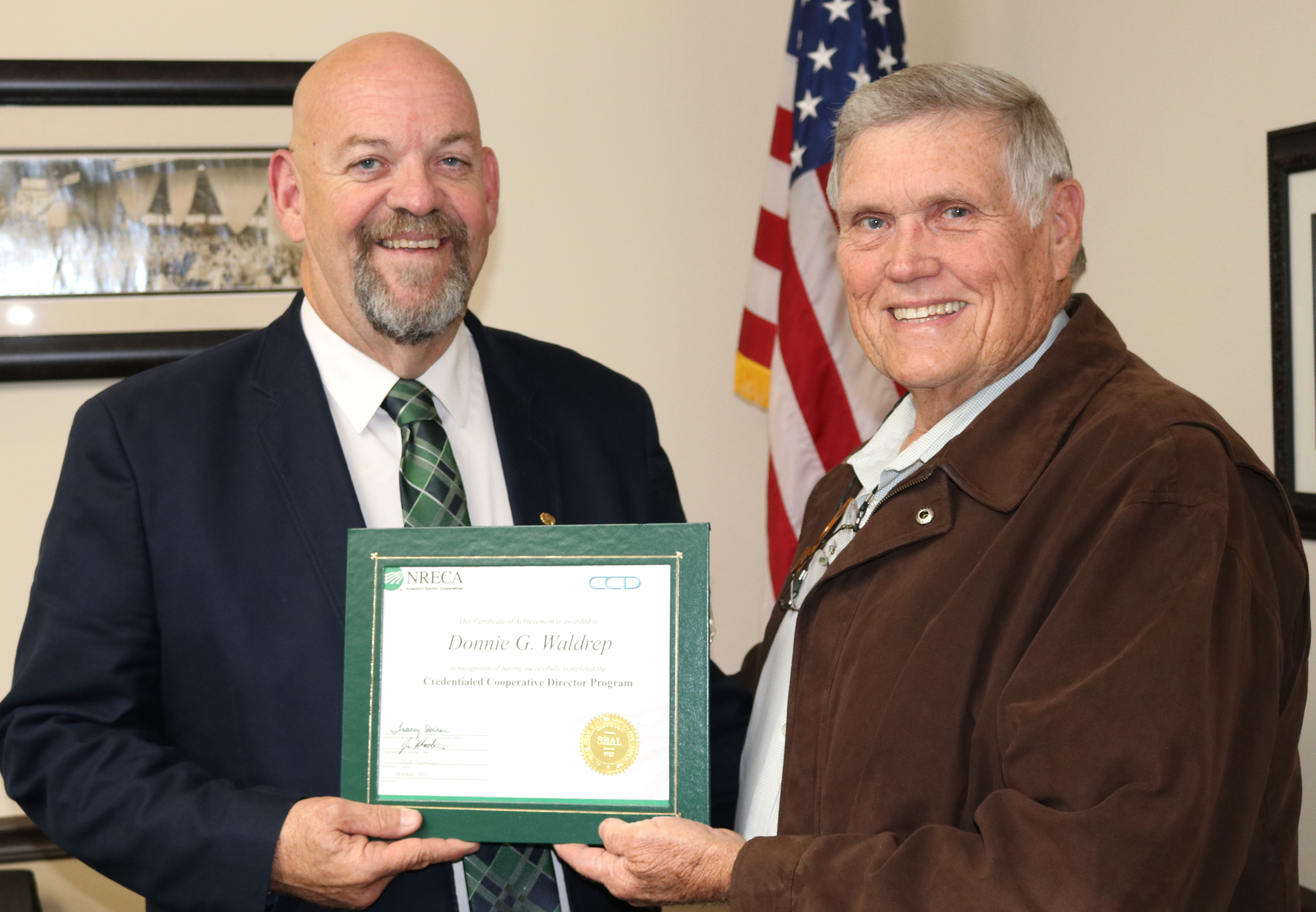 Trustee Donnie Waldrep Recieving his NRECA Certified Cooperative DIrector certificate from Board President Gary Fulford